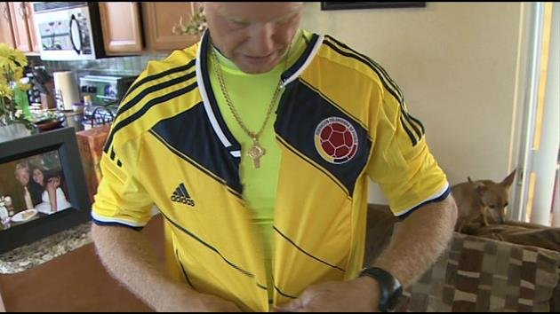 Bob Blair shows off one of his sliced-up World Cup jerseys.