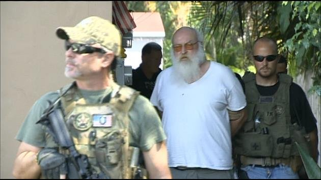 U.S. Marshals arrest Jack Trowbridge (second from left)